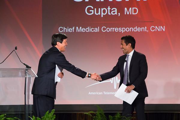 Yulun Wang greets CNN contributor, Dr Sanjay Gupta, at ATA 2015