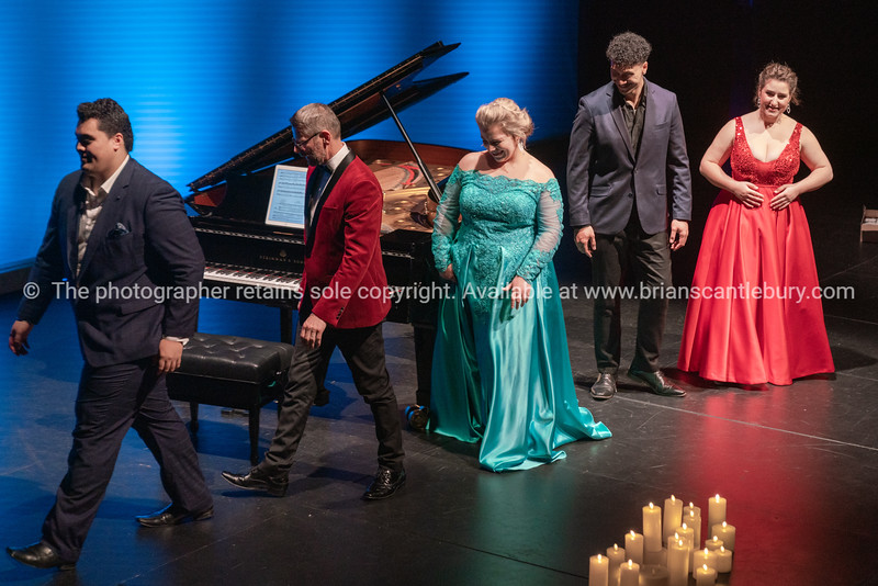 Four singers on stage