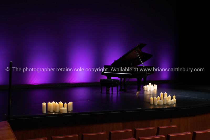 Piano and candles on stage