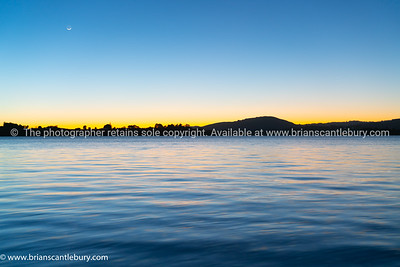 Sunrise over calm bay