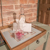 Side table and tray with decanter and crystral bowl against brick wall Property Released; Yes.