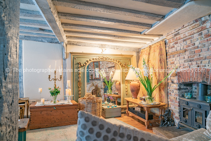 The Tea House Lounge room rustic support and ceiling beams  brick wall and golden hue lighting Property Released; Yes.