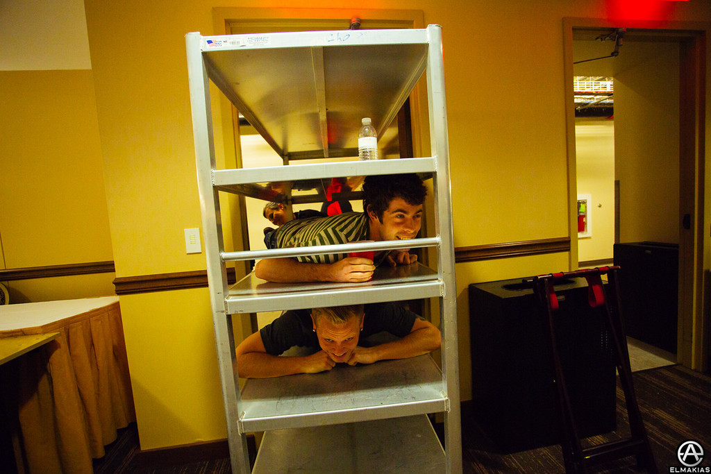 Alex and Josh being delivered on a catering cart to the signing- The House Party Tour