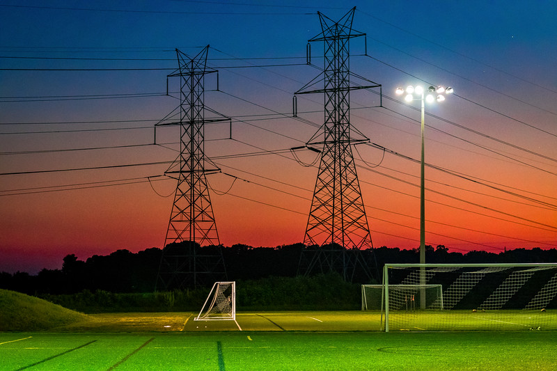 Sunset over South Germantown Parks soccer fields outlines power lines and makes a great comment on the role of electricity in our everyday lives.