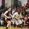 Wootton's Kwame Frimpong drives against QO's Colin Crews