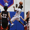 Wootton's Kevin Ayissi-Etoh  drives towards the basket for an easy two point layup.