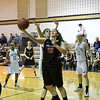 QO's Danni Lehner tries to drive under the basket for a layup