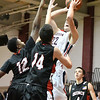Wotton's Zachary Nannen  rises up defenders Ulric Fandalor and Jack Faroane