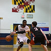 Wootton's Kevin Ayissi-Etoh faces off against Qo's John Fierstein