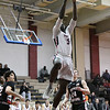 Kwame Frimpong rises for a layup against QO defenders