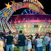 Night at the Fair.  Bright lights attracted large crowds on the mid-way.