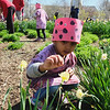 Children from the Chesterbrook Academy in the Kentlands participated with their tied dyed shirts and ladybug headgear by spreading 3,000 ladybugs in a park near the school.
