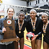 College Park, MD, Ritchie Coliseum: (L to R) NW Coach Stephanie Blake, Janiece Jefferies, Jenaisya Moore, Rachael Bennett standing with MD State 4A Championship trophy