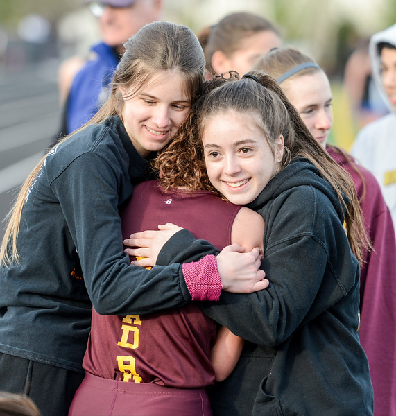 Keeping warm and happy at Broad Run track and field meet against Tuscarora.