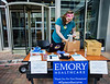 Natalie Thornton, generally a Patient Services Coordinator at Emory, takes inventory of donated items given to Emory University Hospital on Monday, March 30, 2020.  (Jenni Girtman for the Atlanta Journal-Constitution)