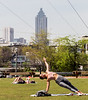 "Making use of the open space at the Beltline Skatepark, Allie Garcia, front, has added yoga to her exercise routine in the past two weeks.  ""I'm new to this,"" she said.  ""I""m kind of winging it on my own,"" on Friday, March 27, 2002.  The city is expecting record heat today.  (Jenni Girtman for the Atlanta Journal-Constitution)"