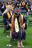 Kennesaw State University holds graduation where Sarah Dismukes, now an official accountant, straightens her cords and sashes before commencement begins Wednesday May 12, 2021 at the college's stadium.  (Jenni Girtman for The Atlanta Journal Constitution)