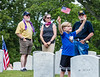 The Marietta National Cemetery did not hold official ceremonies this year, however, small groups gathered to watch the four Blackhawk helicopter flyover on Memorial Day, Monday, May 25, 2020.  Rylan Durocher, 7, of Marietta attended his first Memorial Day event with his family. (Jenni Girtman for The Atlanta Journal Constitution)