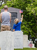 The Marietta National Cemetery did not hold official ceremonies this year, however, small groups gathered to watch the four Blackhawk helicopter flyover on Memorial Day, Monday, May 25, 2020.  Veteran Ryan Durocher, left, brought his family, including 7-year-old Rylan Durocher, to see the Memorial Day flyover. (Jenni Girtman for The Atlanta Journal Constitution)