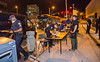 Law enforcement officers makes arrests in downtown Atlanta, fill out booking paperwork in front of the CNN Center and put those who ignored curfew in custody and on corrections busses for transport Saturday, May 30, 2020.  (Jenni Girtman for The Atlanta Journal Constitution)