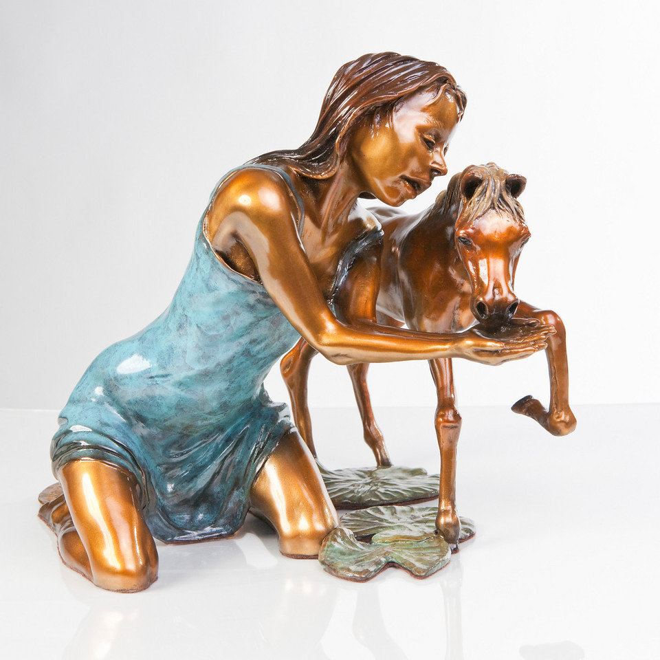 """Images of the bronze scupture work """"Invitation to the Pond"""" by David Soderberg."""