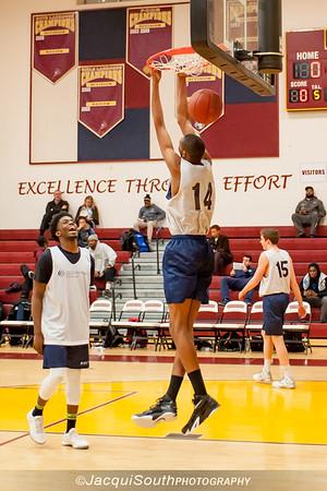 Elliott Brown enjoys a dunk by CKA All-Star teammate Tyjhai Byers during warm-ups.