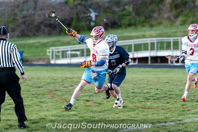 Einstein middie Will Francis (18) keeps the ball away from Magruder middie Cooper Brady (3).