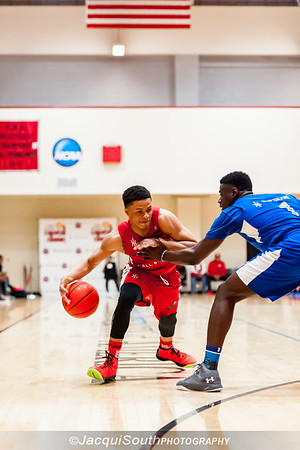 Anthony Cowan (St. Johns, attending University of Maryland) drives to the basket with Rawle Alkins (attending Arizona) on defense.