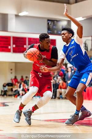 Mohammed Kabir (National Christian drives to the basket with De'Andre Hunter (attending U. Virginia) on defense.