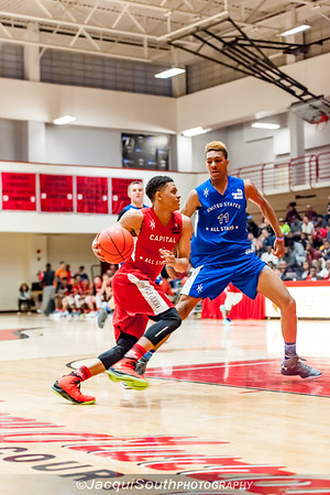 Anthony Cowan (St. Johns, attending University of Maryland) drives to the basket with Charlie Brown Jr. (attending St. Joseph's) on defense.