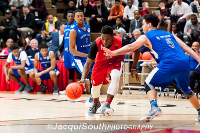 Mohammed Kabir (National Christian drives to the basket with Jahnathan Maxwell (Genesis Academy) on defense.