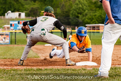 In the 5/9/2016 Damascus v Gaithersburg Baseball game Damascus 1st baseman George Lowe awaits the throw from pitcher Ethan Wentzlaff to keep Gaithersburg runner Grant Mixell on the base.
