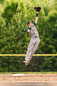 In the 5/9/2016 Damascus v Gaithersburg Baseball game Damascus 2nd baseman Mitchell Kline leaps to catch a throw from the catcher Elliott Brown.