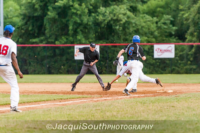 6/27/2016 - The first of two errors by the Tbolts in the 2nd inning, 1st baseman Matthew Mervis stretches for and misses a toss from pitcher William Brown,  Andrew Valichka safe at 1st base. Rockville Express v Silver Spring/Takoma Park Thunderbolts, ©2016 Jacqui South Photography
