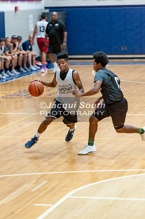 Legend Trotman (Seneca Valley) guards Garret Drummond (Urbana)
