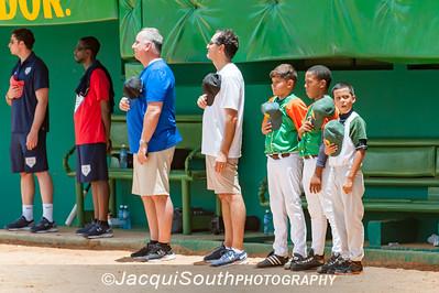 8/3/2016 - Jim Kazunas (left) and Joe Gerbasi (right) and local Cuban bat boys during the National Anthem before the Pinar del Rio vs Cal Ripken College Baseball team