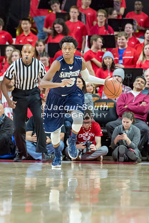 12/10/2016 - Antwon Portley brings the ball upcourt in the St. Peter's v University of Maryland Basketball game, ©2016 Jacqui South Photography