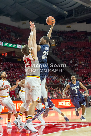 12/10/2016 - Samuel Idowu shoots a hook shot over Ivan Bender in the St. Peter's v University of Maryland Basketball game, ©2016 Jacqui South Photography