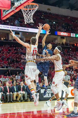 12/10/2016 - Trevis Wyche shoots over Ivan Bender in the St. Peter's v University of Maryland Basketball game, ©2016 Jacqui South Photography