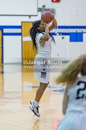 1/19/2017 - Magruder sophomore guard Laila Grant (5) shoots a 3-point shot, ©2017 Jacqui South Photography