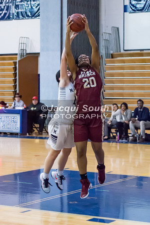 1/19/2017 - Paint Branch's Olivia Merdhant (20) & Magruder's Shanna Yeh (11) fight for a rebound, ©2017 Jacqui South Photography