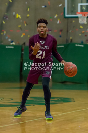 2/21/2017 - St. Anselm's guard Jimi Olopade (21) directs the offense , ©2017 Jacqui South Photography