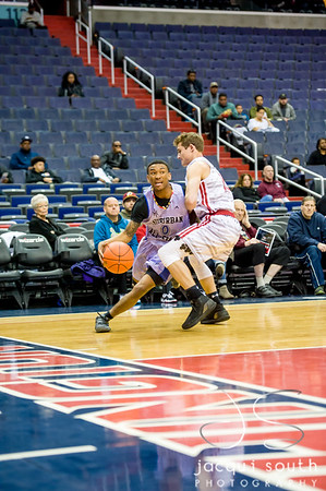 4/8/2017 - Kobe Colston (Blake High School) guarded by Reese Mona (St. John's) in the District v Suburban All-Star Capital Classic game, ©2017 Jacqui South Photography