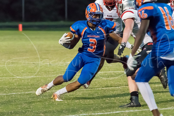 9/1/2017 - Watkins Mill linebacker Clint Okoli (11) almost tackles Blair runningback Christopher Watkins (21) behind the line of scrimmage, Blair v Watkins Mill Football, Photo Credit: Jacqui South
