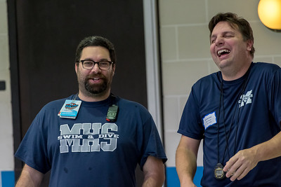 1/20/2018 - Magruder Coach Jeremy Snyder (left) and head timer Ben Powell enjoy the pregame warmups, Blake v Magruder Swim & Dive, ©2018 Jacqui South Photography