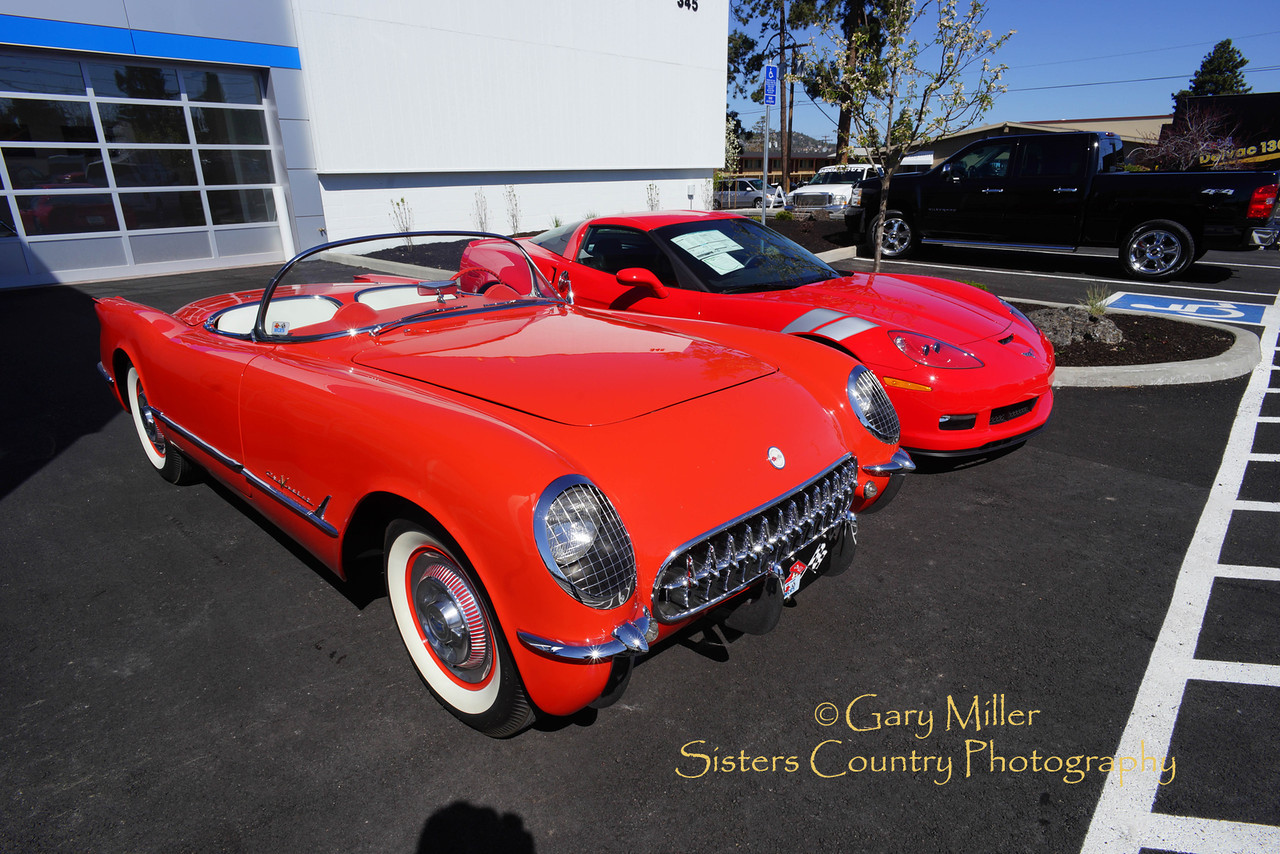 1955 Corvette restored and owned by Rodger Dwight meets the brand new commemorative 60th edition 2013 Grand Sport at Lithia Motors in Bend, Oregon on May Day 2013  - Copyright © 2013 by Gary N. Miller