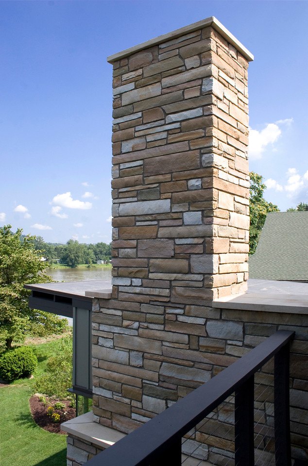 Rear view: stone chimney fireplace from 2nd floor balcony
