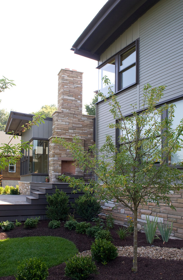 Rear perspective with stone chimney