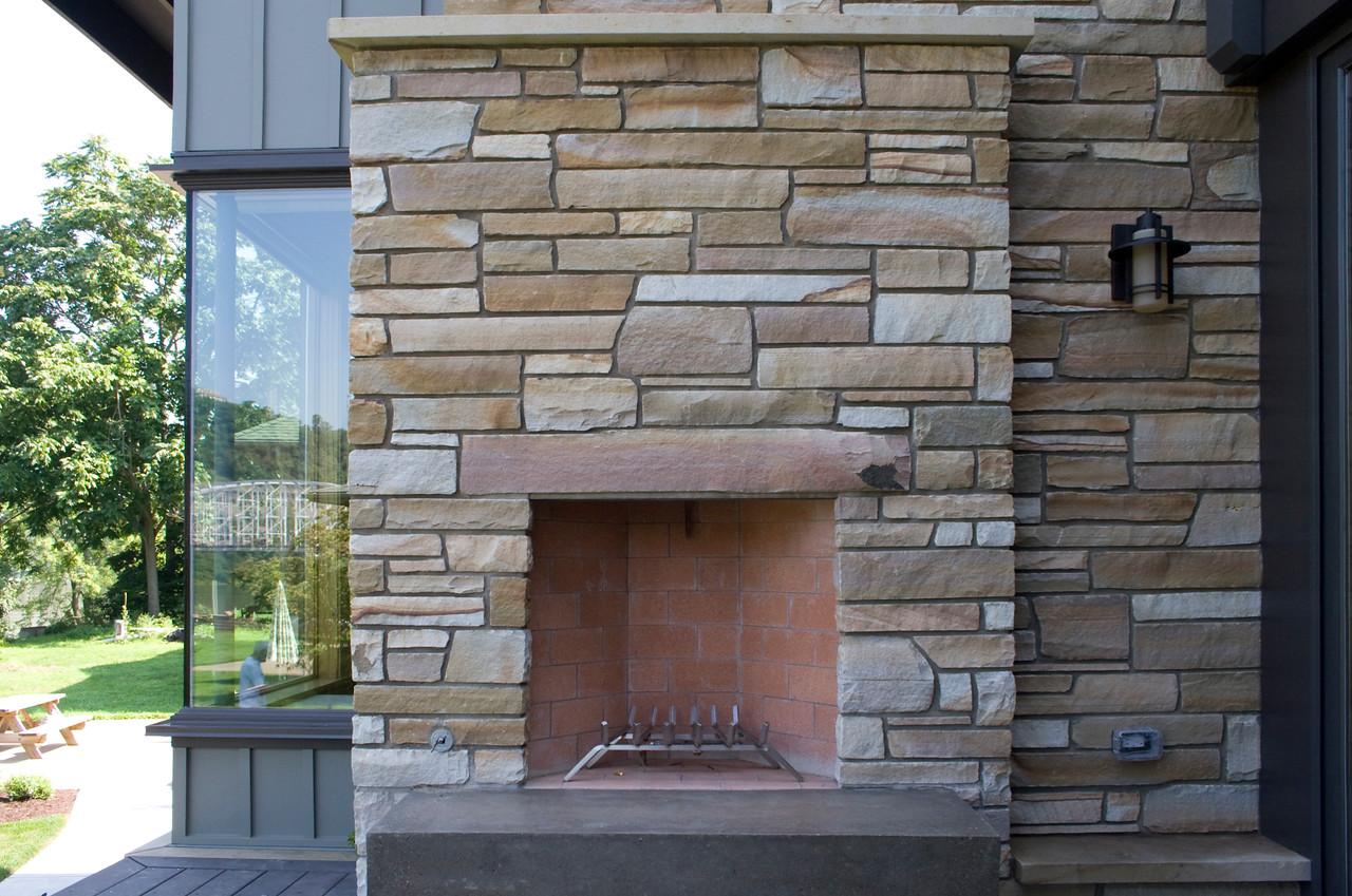 Rear view: stone chimney fireplace