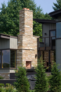 Rear view: rear porch and stone chimney